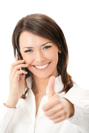 Happy smiling successful businesswoman with cell phone and thumbs up gesture, isolated on white background photo