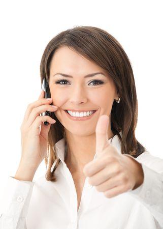 secretaria: Feliz empresaria exitosa sonriente con tel�fono celular y pulgares arriba gesto, aislados en fondo blanco Foto de archivo