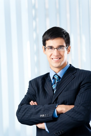 Portrait of successful happy smiling businessman at office photo