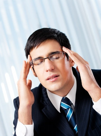 Thinking, tired or ill with headache businessman at office Stock Photo - 8343895