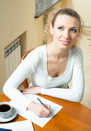 Portrait of young thinking woman writing, at home Stock Photo - 8390546