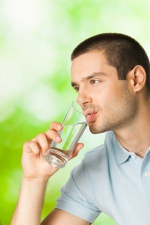 Young man drinking water, outdoors Stock Photo - 8421140