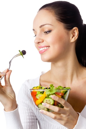 antioxidants: Portrait of happy smiling woman with vegetarian vegetable salad, isolated on white background