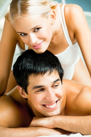 Young attractive happy amorous couple at bedroom Stock Photo - 8629897