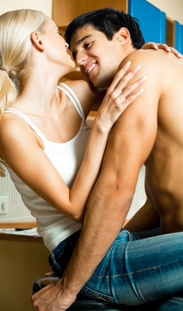 Young happy smiling amorous couple embracing at home photo