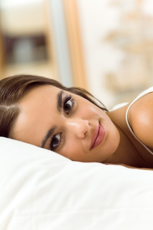 awaking: Young happy smiling woman waking up at bedroom