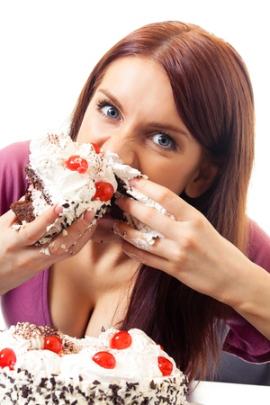 Young hungry gluttonous woman eating pie, isolated on white background Stock Photo - 8773039