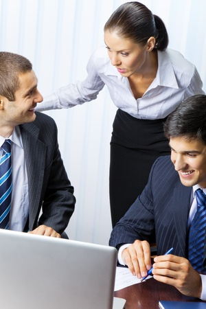 Three businesspeople working at office Stock Photo - 8773234