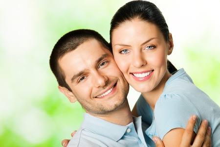 Portrait of young happy smiling amorous couple, outdoors photo