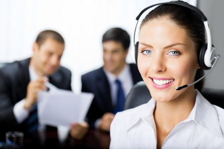 Portrait of happy smiling female support phone operator at workplace Stock Photo - 8773395