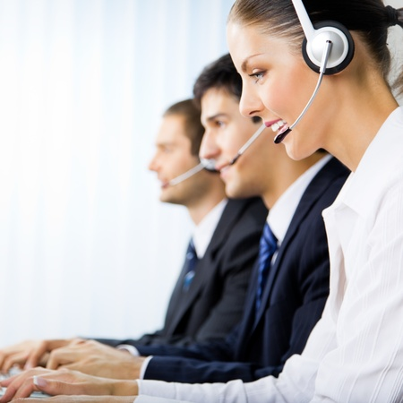 handsfree phone: Three support phone operators at workplace