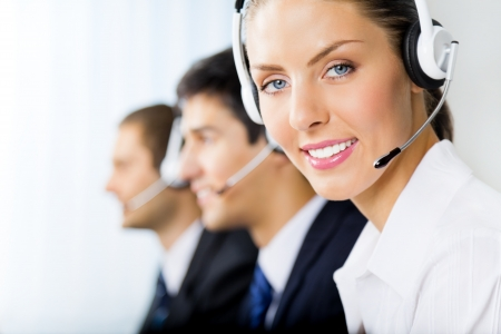 phone support: Three support phone operators at workplace