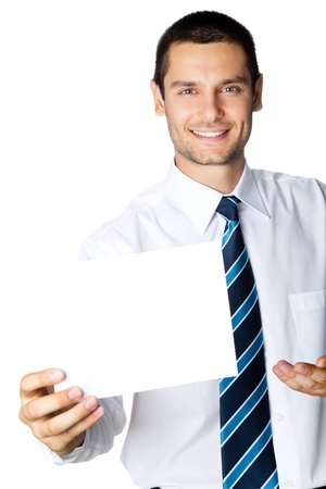 Young happy smiling businessman showing signboard with copyspase for text or slogan, isolated on white background photo