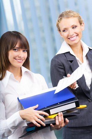 Two businesswomen working with documents at office photo
