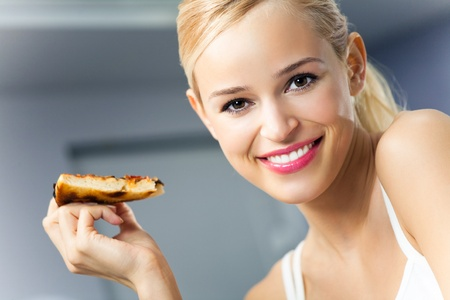 fastfood: Young happy woman with pizza, indoors