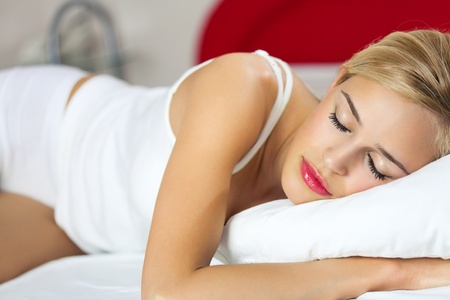 lazyness: Portrait of young sleeping woman at bedroom Stock Photo
