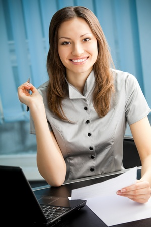 Portrait of writing happy smiling businesswoman working at office Stock Photo - 9037014