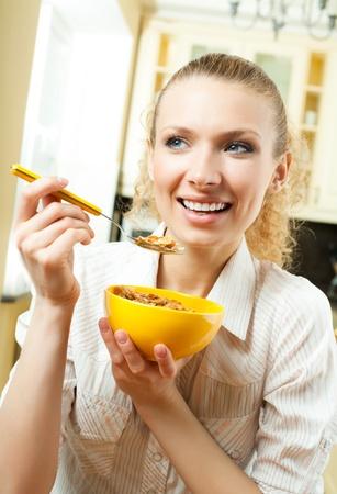 muslin: Young smiling woman eating muslin at home