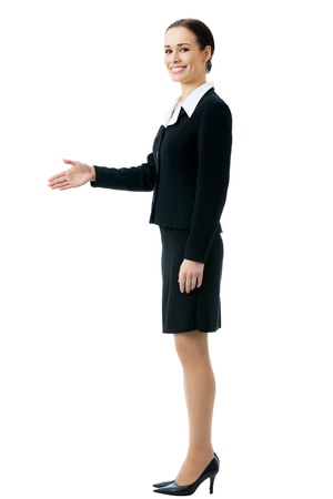 Full body portrait of smiling businesswoman giving hand for handshake, isolated on white background photo