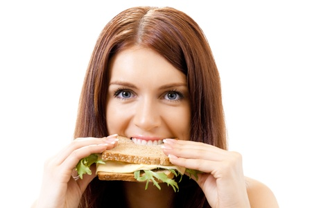 gluttonous: Very hungry gluttonous woman eating sandwich with cheese, isolated on white background Stock Photo