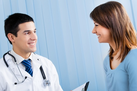 Young doctor and female patient with prescription at office Stock Photo - 9340537