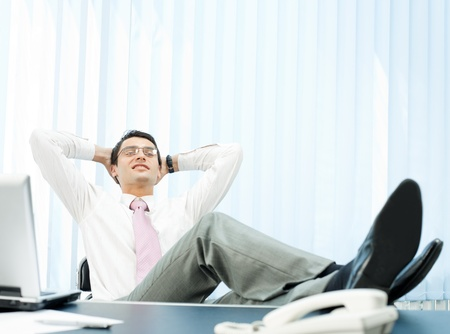 Happy relaxing businessman at office Stock Photo - 9340546