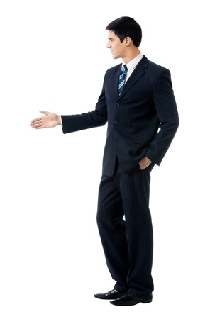 Full body portrait of young business man giving hand for handshake, isolated on white background photo