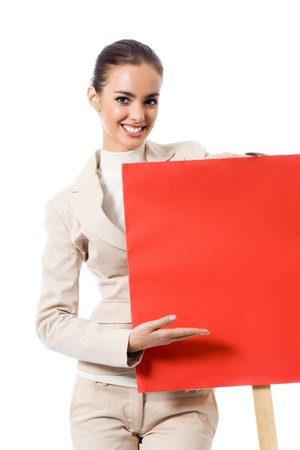 Happy young business woman showing blank red signboard, isolated on white background photo