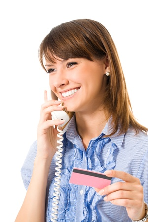 pay bills: Young happy smiling business woman with plastic card, on cellphone, isolated on white background