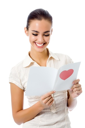 Young happy woman with valentine card, isolated on white background