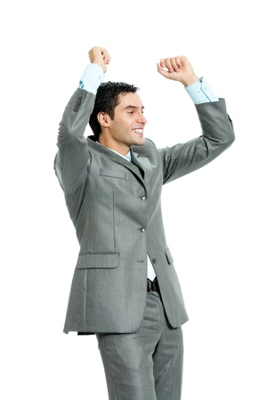 Very happy successful gesturing young business man, isolated on white background photo