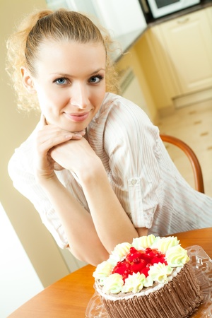 Young happy smiling beautiful young woman eating torte at home Stock Photo - 9896097