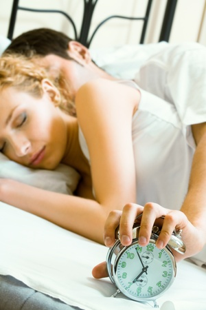Young amorous couple waking up at the morning Stock Photo - 9896067