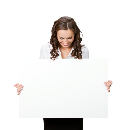 woman holding sign: Happy smiling young business woman showing blank signboard, isolated on white background Stock Photo