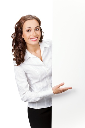 whitebackground: Happy smiling young business woman showing blank signboard, isolated on white background Stock Photo