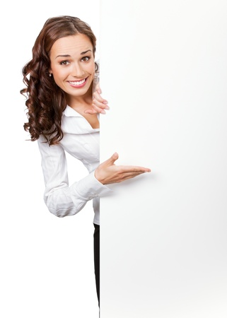 Happy smiling young business woman showing blank signboard, isolated on white background photo