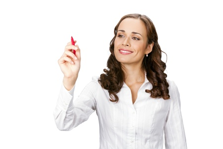 Happy smiling cheerful young business woman writing or drawing on screen with red marker, isolated on white background photo