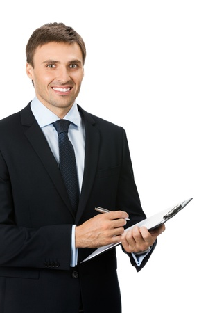 Happy smiling young businessman with clipboard writing, isolated on white background photo