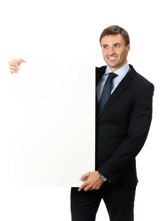 Happy smiling young business man showing blank signboard, isolated on white background photo