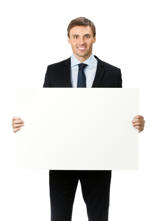 a placard: Happy smiling young business man showing blank signboard, isolated on white background Stock Photo