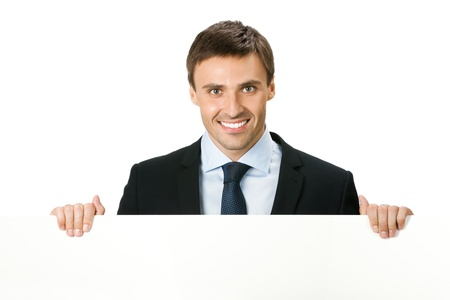 Happy smiling young business man showing blank signboard, isolated on white background Stock Photo - 9896340