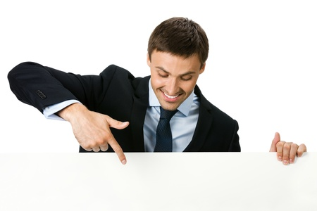 Happy smiling young business man showing blank signboard, isolated on white background Stock Photo - 9896357