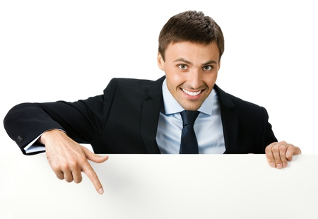 Happy smiling young business man showing blank signboard, isolated on white background Stock Photo - 9896356