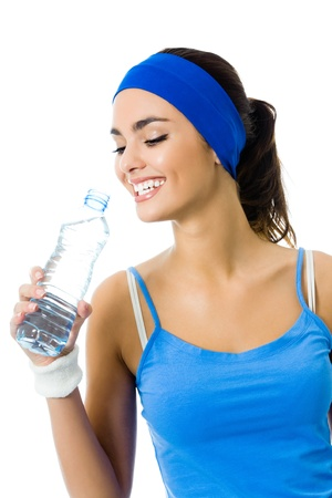 aerobic exercise: Happy smiling young woman in sportswear drinking water, isolated on white background Stock Photo