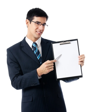 Young happy smiling businessman showing clipboard, isolated on white background photo