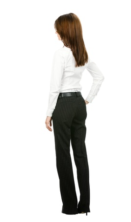 Full body of young business woman looking at something, from the back, isolated on white background