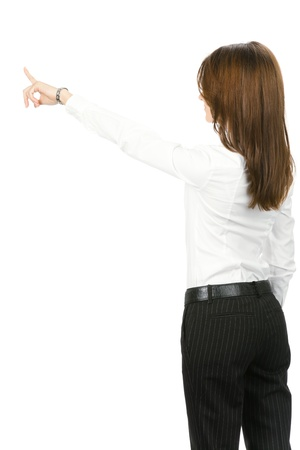 Young business woman pointing at something in her back, isolated on white background Stock Photo - 10024937