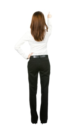 Full body of young business woman pointing at something in her back, isolated on white background Stock Photo - 10024931
