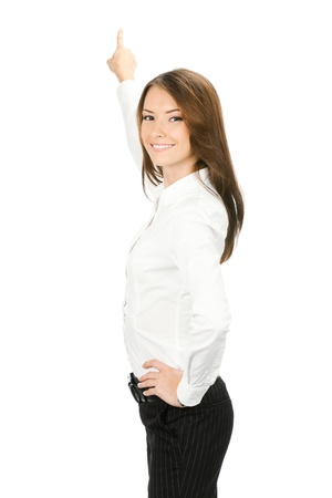 whitebackground: Portrait of young business woman pointing at something in her back, isolated on white background