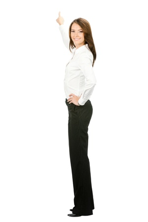 executive assistants: Full body of young business woman pointing at something in her back, isolated on white background Stock Photo